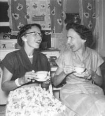 women lauhging