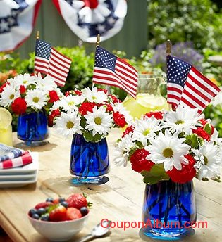red white blue flowers and flags in jars